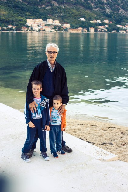 Slavko Lekić with grandsons Stracnia and Lazar, fishing in front of the deserted Hotel Fjord